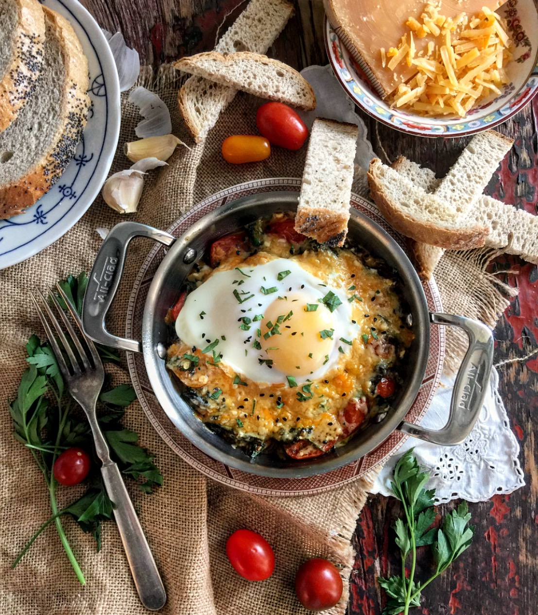 Blissful Baked Eggs with Smoked Cheddar, Kale and Harissa Cherry Tomatoes