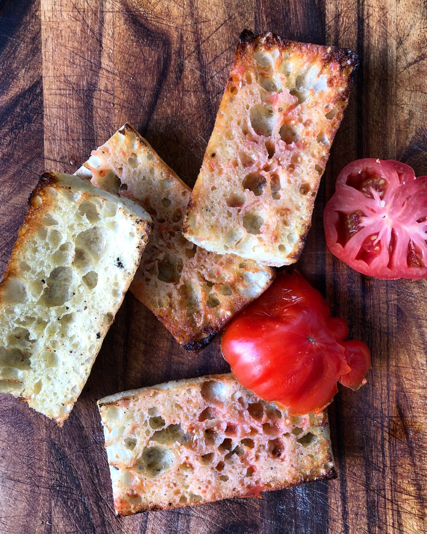 Grilled Ciabatta with olive oil, and rubbed tomato, pan con tomate