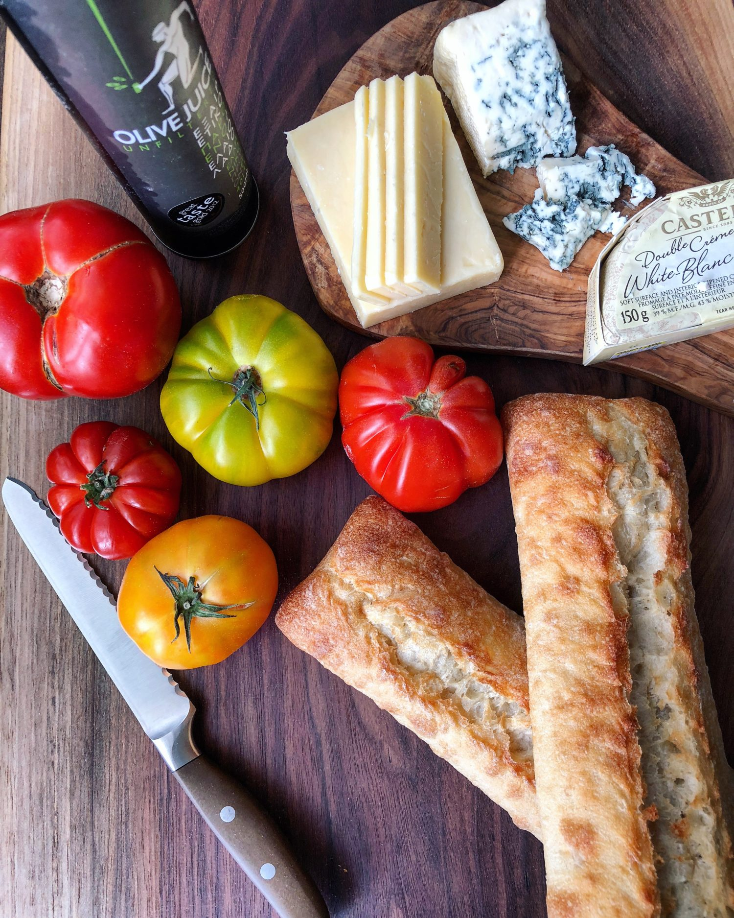 Grilled Ciabatta with olive oil and tomato, and cheeses, pan con tomate