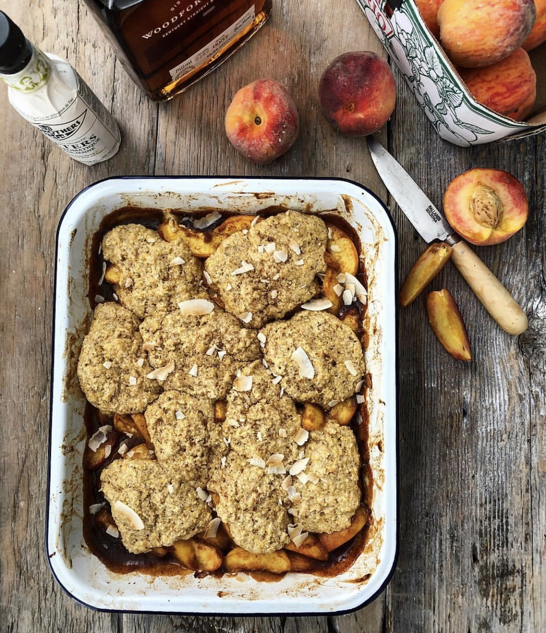 Spicy Maple Bourbon Peach Cobbler with a Cornmeal Biscuit Topping