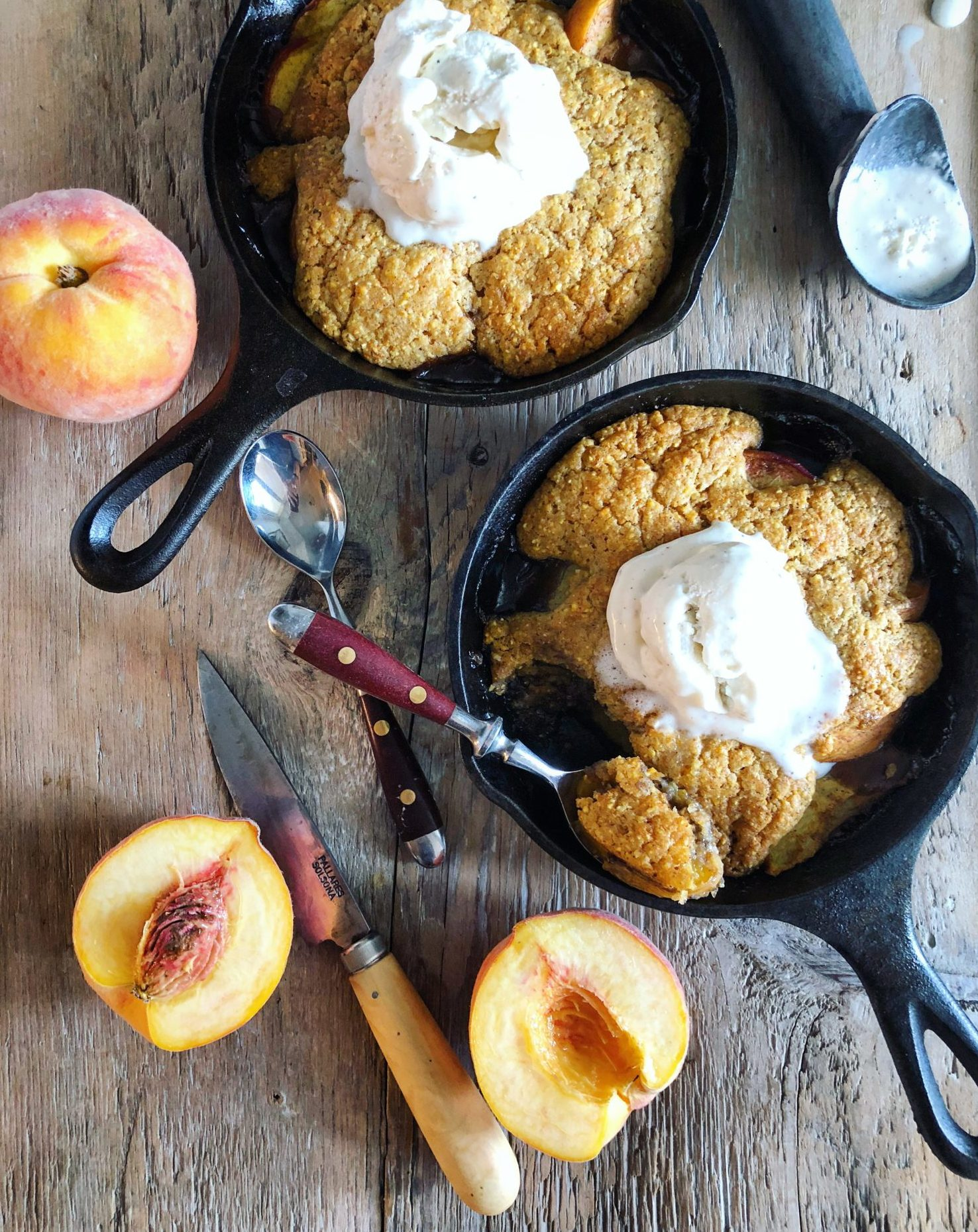 Spicy Maple Bourbon Peach Cobbler with Cornmeal Biscuit Topping