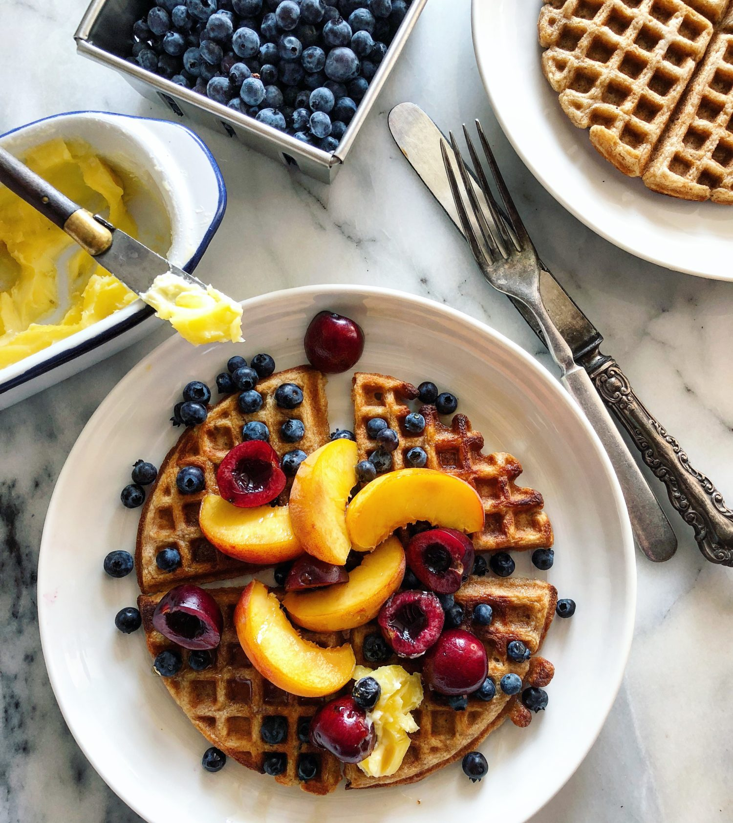 Peaches and wild berries on Earl Grey Waffles