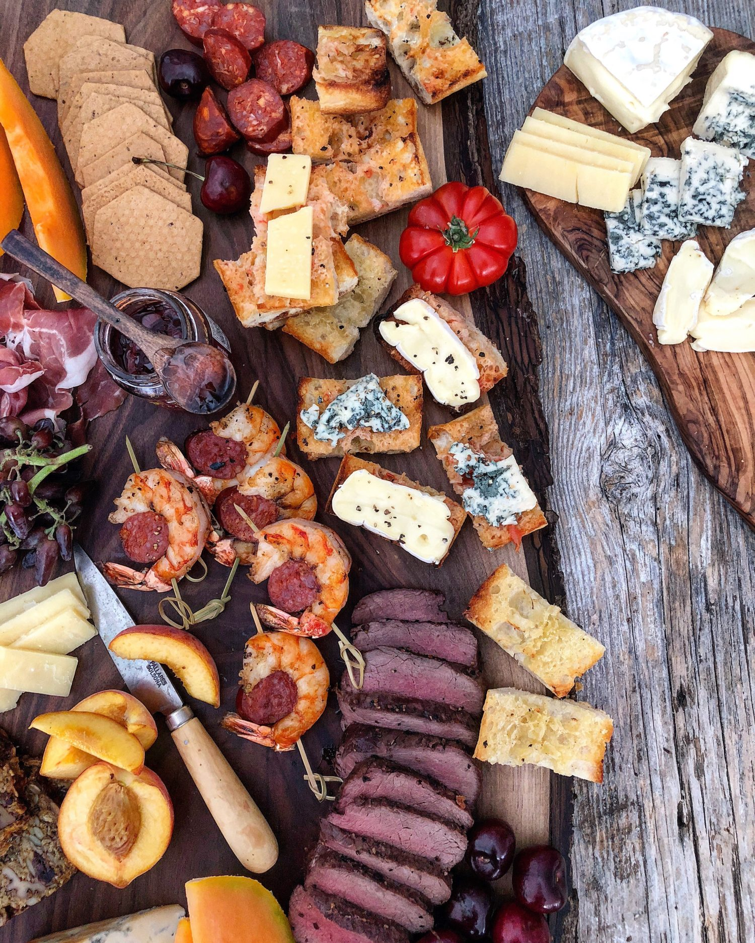 Summer Grilling Cheeseboard with venison, shrimp and pan con tomate