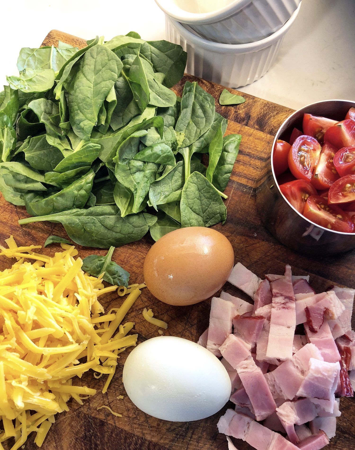 Baby Spinach, cherry tomatoes, grated cheddar cheese, eggs and double smoked bacon for Baked Eggs