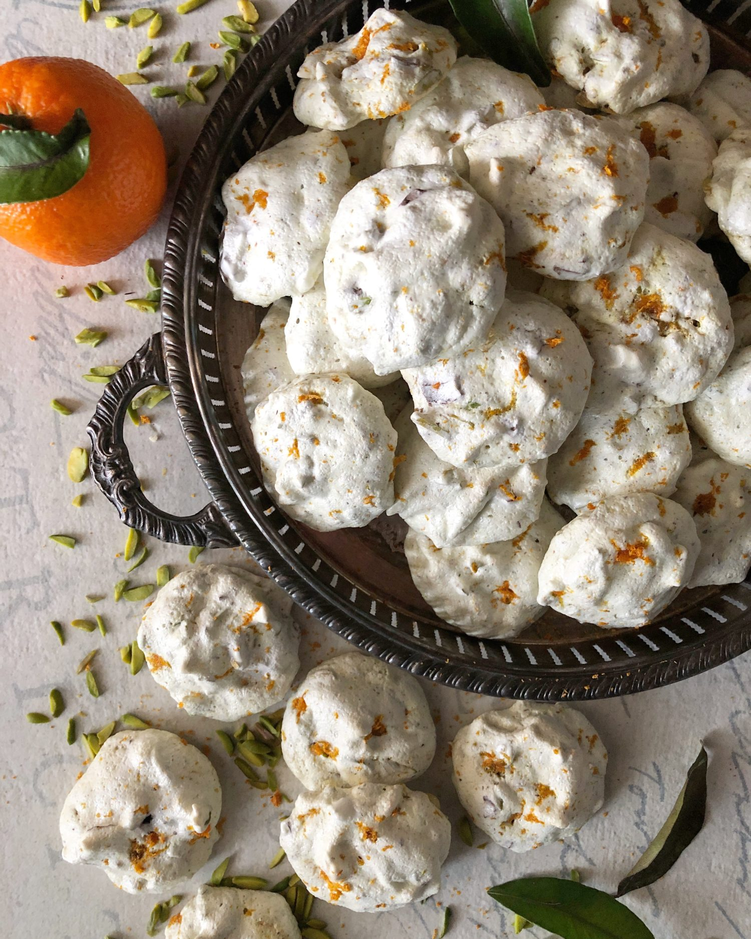 tender orange, pistachio and chocolate meringue cookies, forget-me-nots