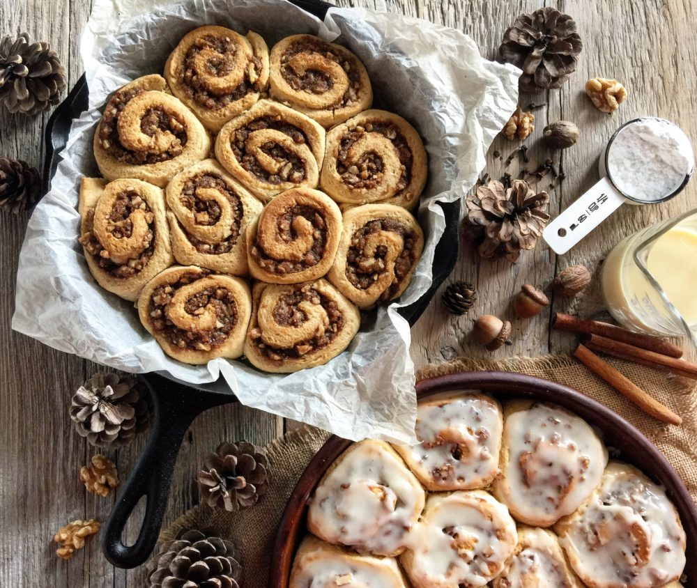 eggnog cinnamon rolls with walnuts and coffee